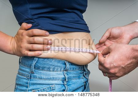 Doctor Treats A Woman With Overweight