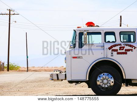 BOMBAY BEACH, CALIFORNIA, USA - MAY 26, 2015: Parked white fire engine of the Imperial County Fire Department.