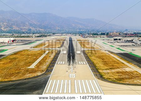 BURBANK, USA - MAY 27, 2015: Aerial view of the airport with runways hangars and parked airplanes.