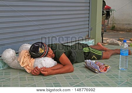 Pattaya Thailand - March 21 2015: homeless man is sleeping outdoor in Pattaya Thailand