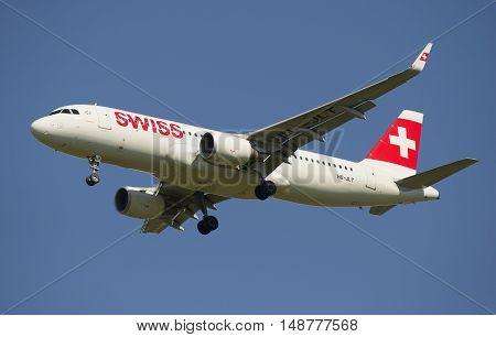 SAINT PETERSBURG, RUSSIA - AUGUST 21, 2015: Airbus A320 (HB-JLT) Swiss International Air Lines before planting