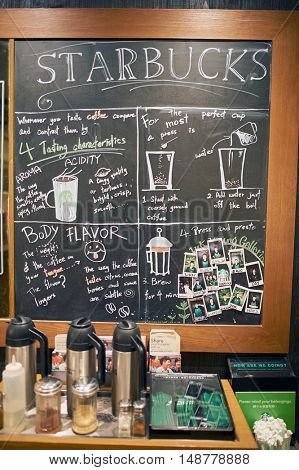 HONG KONG - CIRCA JANUARY, 2016: blackboard inside of Starbucks store in Hong Kong. Starbucks Corporation is an American coffee company and coffeehouse chain.