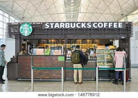 HONG KONG - CIRCA JANUARY, 2016: Starbucks in Hong Kong International Airport. Starbucks Corporation is an American coffee company and coffeehouse chain.