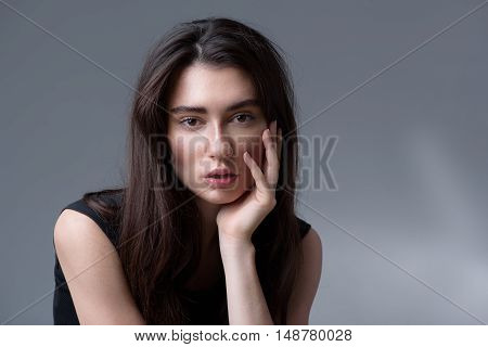 beauty and skincare concept, portrait of a calm woman thinking and looking into camera