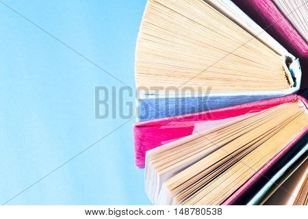 Top view of colorful hardback books in a circle. free copy space. Back to school copy space. Education background.