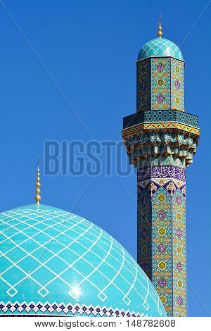 Blue dome of a mosque and minaret