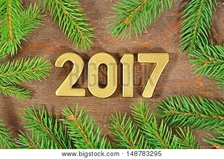 2017 Year Golden Figures And A Spruce Branch