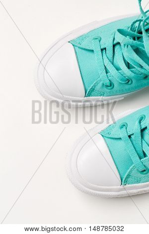 Top view of sneakers on white background.