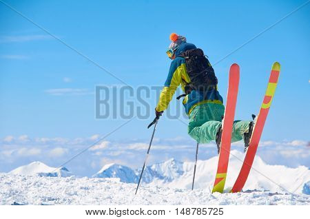Extreme ski rider watch to mountains in perfect pose. Beautiful winter sport or games concept. Interesting adventure for holiday or weekend. Color snowboard rider.