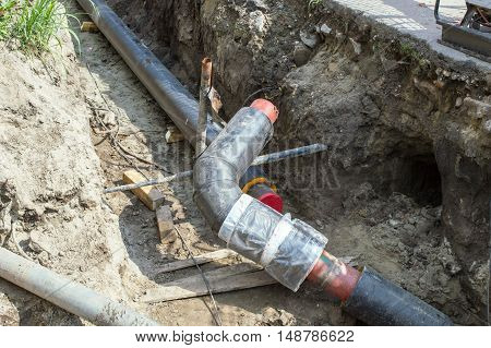 Two Pipes in the Earthen Trench for Making the Pipeline. Wide Pipes in the Earthen Trench for Heating System. Pipeline for Heating System.