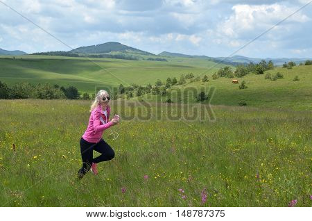 Jogging Woman On Spring Field