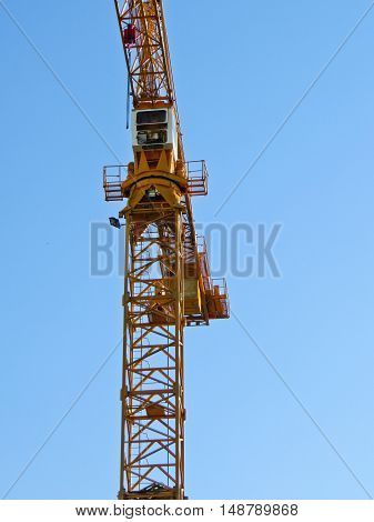 the construction crane against deep blue sky
