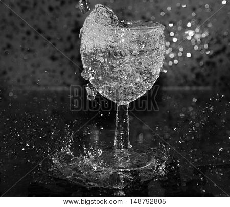 squirt, splash of water on a black background, drops, glass