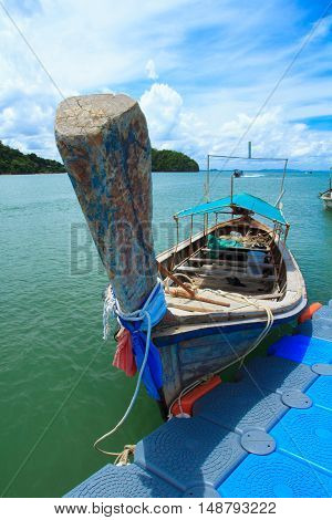 Boat dock waiting passengers are tourists Railay Beach.