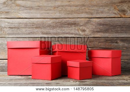 Stacks Of Red Boxes On Grey Wooden Table