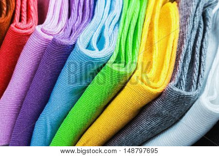 Textile colorful socks background. Green, pink, red, blue yellow and other colors