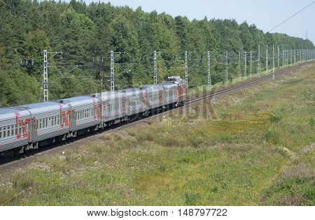 LENINGRAD REGION, RUSSIA - JULY 17, 2015: Stretching into the distance on a passenger train