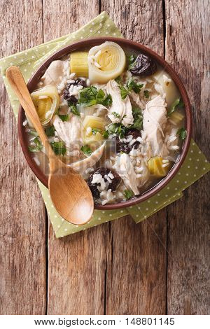 Scottish Cock-a-leekie Soup With Leeks And Prunes Close Up In A Bowl. Vertical Top View