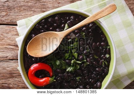 Stewed Spicy Black Beans Close Up In A Bowl. Horizontal Top View