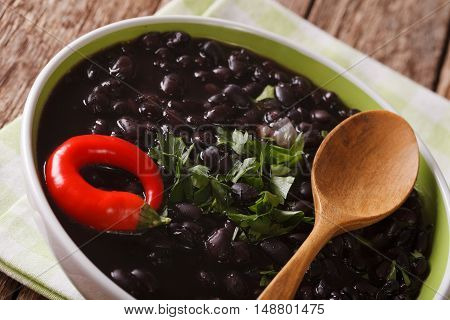 Vegetarian Food: Spicy Black Beans Close Up In A Bowl. Horizontal