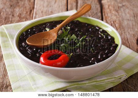 Vegetarian Black Bean Soup Close Up In A Bowl. Horizontal