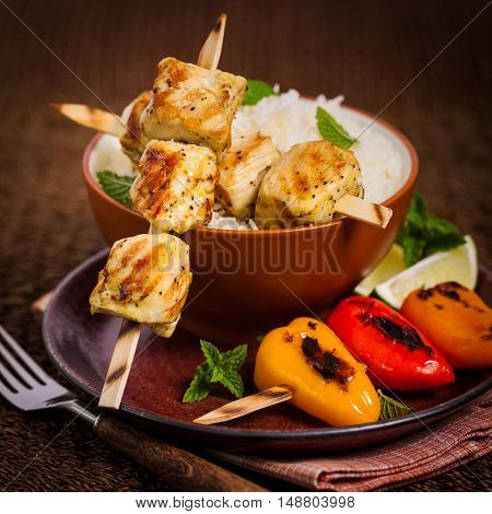 Chicken Kebab or Kabob Skewers with Rice. Selective focus.