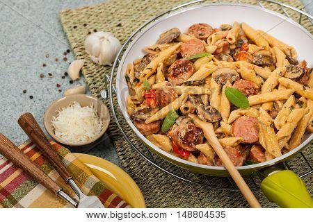 Homemade Sausage Pasta Alfredo Dinner. Selective focus.