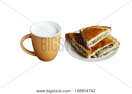 tasty and healthy mushroom pie and cup of milk for a healthy diet. isolated on white background without shadows. easy to cut to your design.