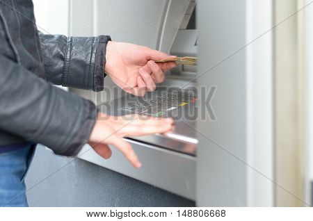 Young Woman Making A Banking Withdrawal