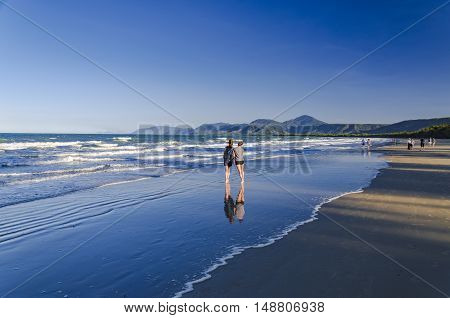 PORT DOUGLAS; AUSTRALIA - AUGUST 28, 2014: Sunset at the beach of Port Douglas in the tropical Queensland.