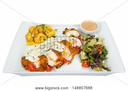 Breaded roll of chicken with zucchini topped with sauce, garnished with lettuce and tomatoes.