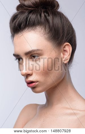 skin and hair care concept, face of a young modern brunette