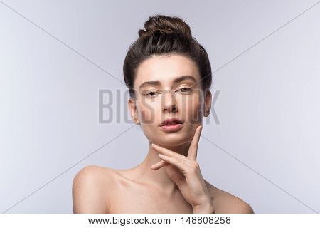 skin care and vogue concept, portrait of a relaxed modern woman with copy space
