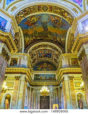 SAINT PETERSBURG RUSSIA - APRIL 25 2015: The splendid prayer hall of St Isaac's Cathedral that boasts several tons of silver and golden embellishments on April 25 in Saint Petersburg.