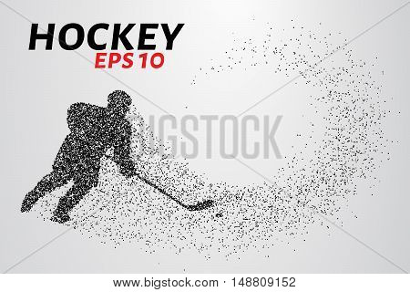 Hockey player of the particles. Silhouette of a hockey player consists of points. Vector illustration
