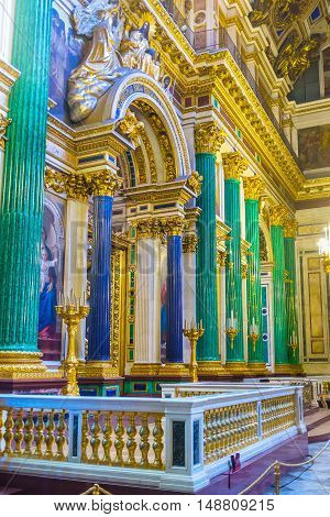 SAINT PETERSBURG RUSSIA - APRIL 25 2015: The iconostasis of St Isaac's Cathedral is framed by semiprecious stone columns green malachite and blue lazurite on April 25 in Saint Petersburg.