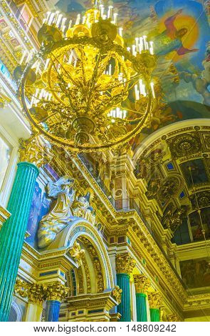 SAINT PETERSBURG RUSSIA - APRIL 25 2015: The St Isaac's Cathedral boast unique and splendid decorations of different technics making it one of the most interesting and expencive object of art on April 25 in Saint Petersburg.