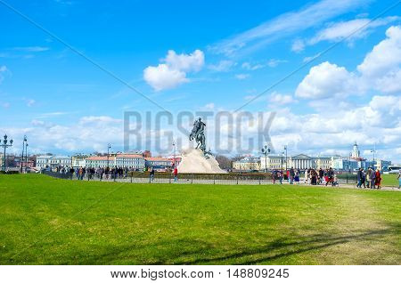 SAINT PETERSBURG RUSSIA - APRIL 25 2015: The tourists around the Bronze Horseman monument of Peter the Great located in Senate Square on April 25 in Saint Petersburg.