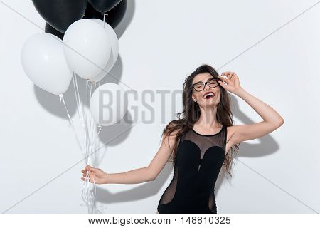 smiling sexy woman posing in glasses on white background with copy space