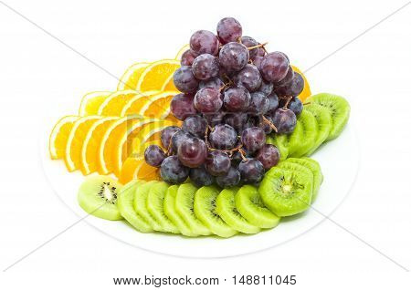 a large plate of sliced fruit on white background