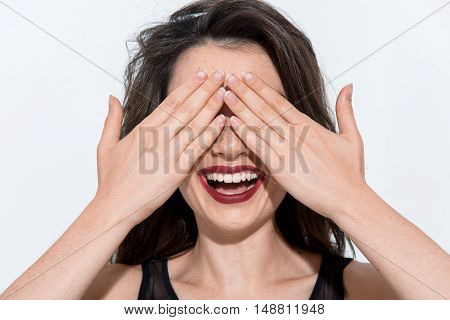 beautiful excited woman standing on white background