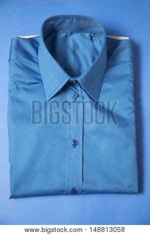 Blue business shirt packed on the blue background.