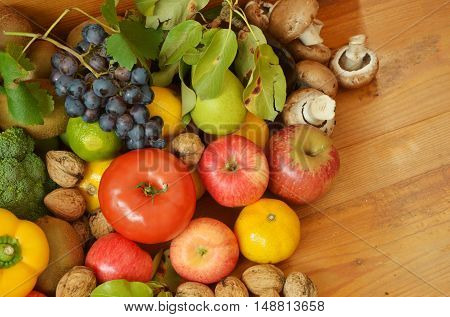 many colorful fruits and vegetables on floor