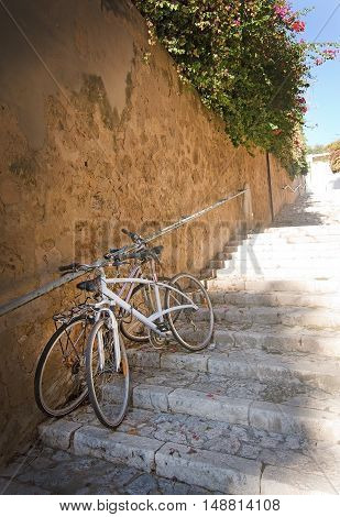 Staircase with parked bicycles on a sunny morning in Palma de Mallorca Balearic islands Spain.