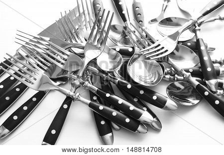 many Cutlery and knife on white background