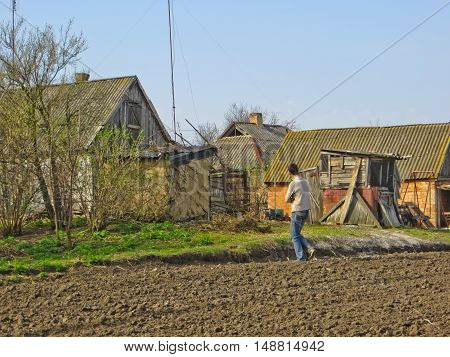 Farmer on a ploughed field on summer
