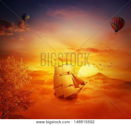 Vintage old ship sailing lost in the sky. Adventure and journey concept. Beautiful sunset background over the clouds