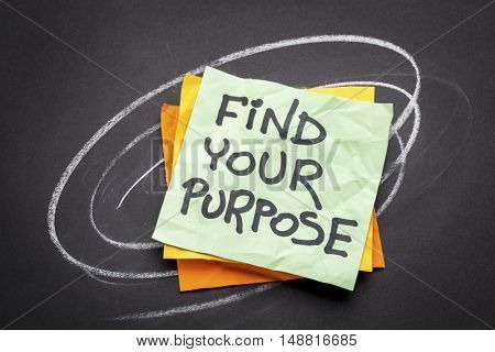 find your purpose  - motivational reminder - handwriting on a sticky note against black paper