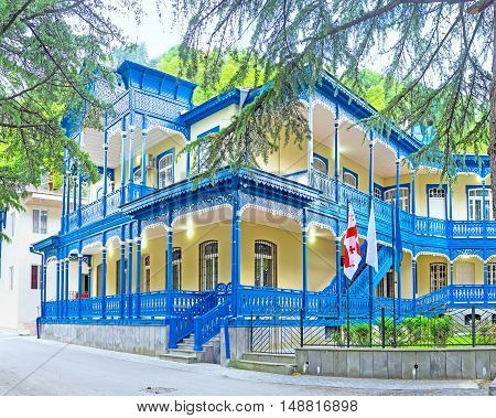 The old mansion with deep blue wooden terraces decorated with carved patterns and pillars Borjomi Georgia.