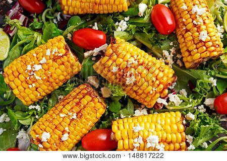 Delicious oven cooked Corn with feta cheese, paprika, lime, vegetables